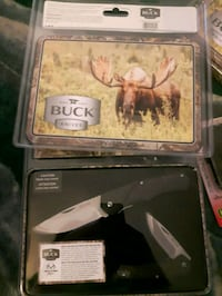 New buck knives in metal tin