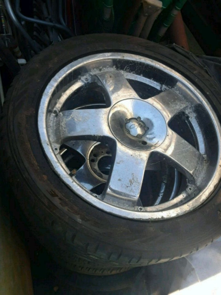 Photo 4 18 inch 5 lug rims universal. tires are all shot don't hold air