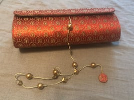 Red and gold clutch purse