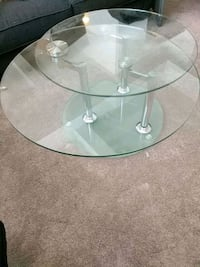 Coffee Table: glass top surfaces rotate for different looks