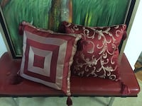 Red and gold reversible throw pillows 3 mi
