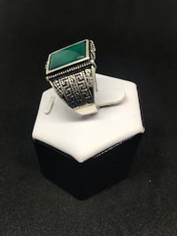 silver and green gemstone ring 562 km