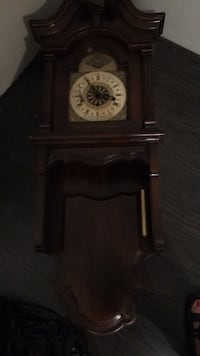 black and brown wooden pendulum clock Grimsby, L3M