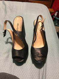 pair of black leather peep-toe slingback wedge shoes