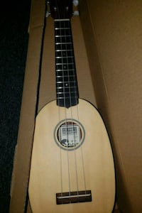 brown and black acoustic guitar Fresno, 93703