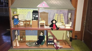 Dollhouse with furniture included and 4 dolls -Madeline book series.