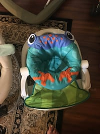 baby's green and white bouncer 294 mi