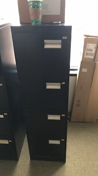 Black metal cabinet...heavy duty paid over $400 21 mi
