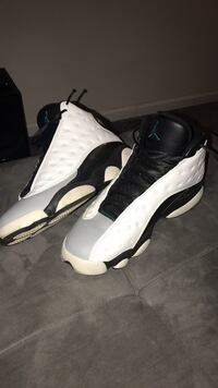 pair of white-and-black Air Jordan 13 Woodbridge, 22191