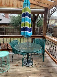 Outdoor table, umbrella and chairs