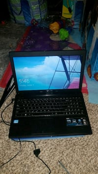 black laptop computer with charger Auburn, 98092