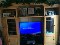 flat screen television with brown wooden TV hutch Fullerton, 92832