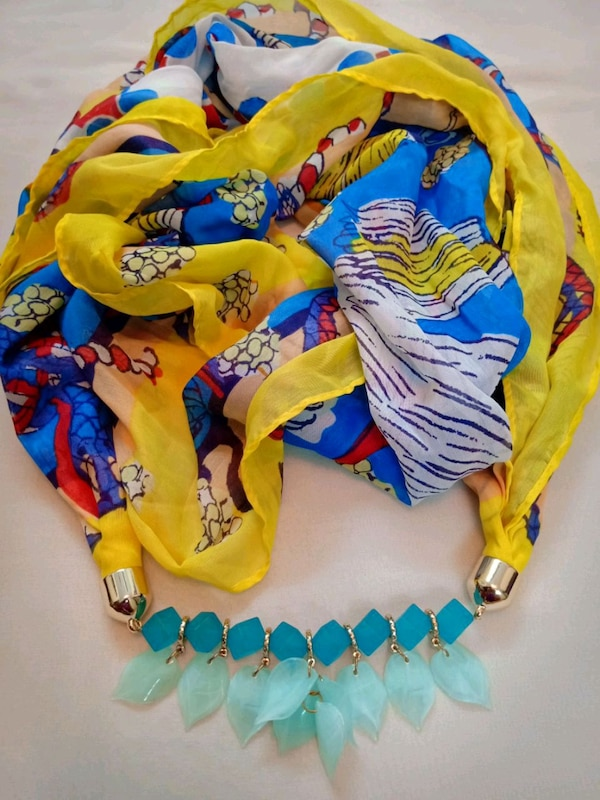 yellow, blue, and red floral textile
