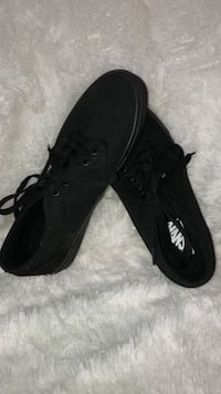 pair of black Vans low-top sneakers 150 mi