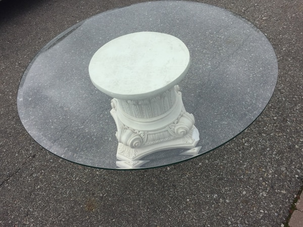 Pedestal and glass top coffee table