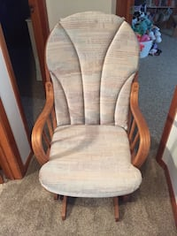 brown wooden framed gray glider chair