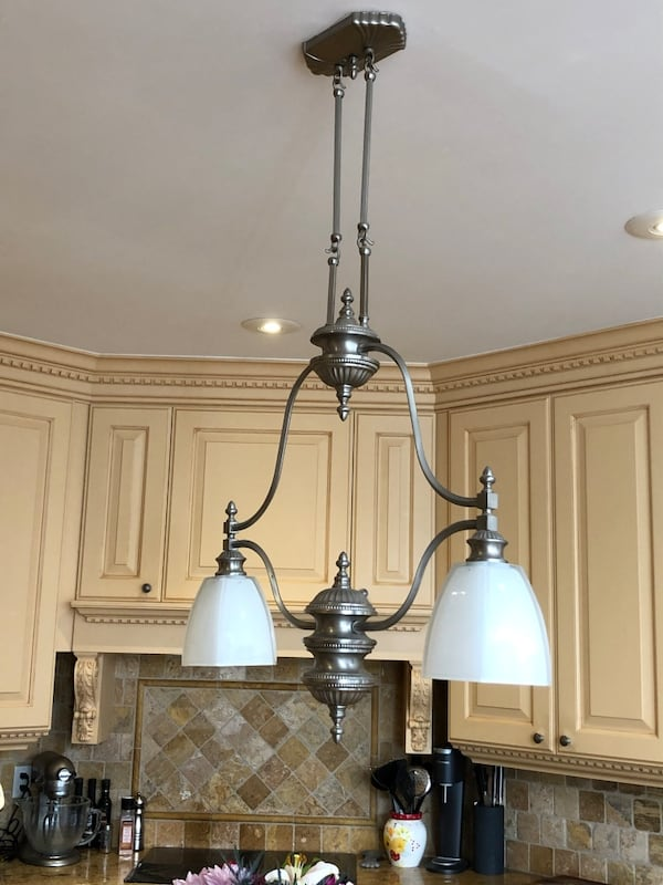 Brushed nickel pendant chandelier.  Great for an island! 53fc531a-dc27-4a2b-875f-ca66316e3370