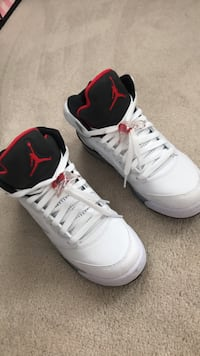 Pair of white-and-black air jordan basketball shoes