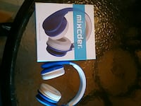 blue-and-white Mixcder cordless headphones with box