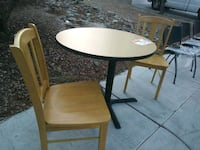 round brown wooden table with two chairs 2057 mi