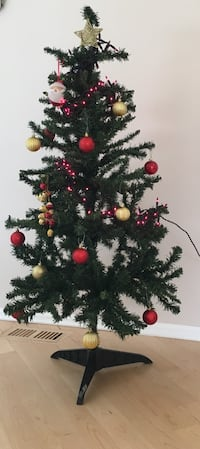 4ft Christmas tree with ornaments . Could give more ball ornaments than in the picture.  Buffalo Grove, 60089