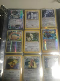 nine assorted Pokemon trading cards with album Parkville, 21234