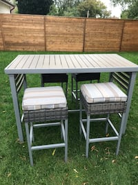 Outdoor patio table set with four stools. Bar height. Mississauga, L5E 2E9