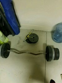 black and gray barbell and two black dumbbells Cape Coral, 33991