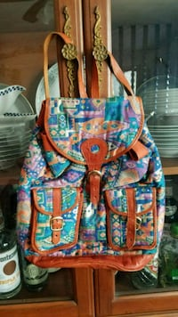 blue, red, and white floral backpack