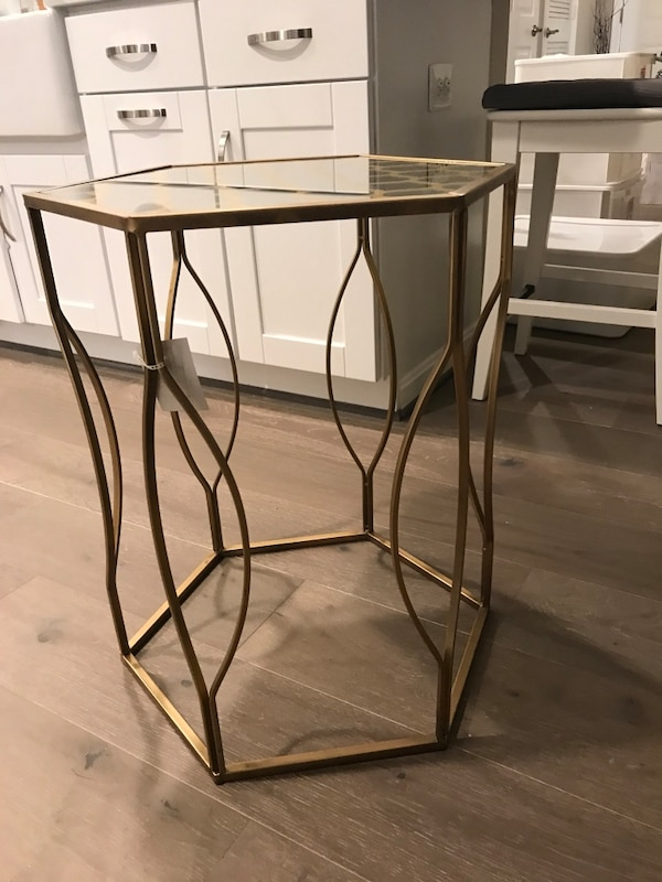 Metal framed glass top side table/night stand.