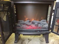 Black electric fire place, makes great heat