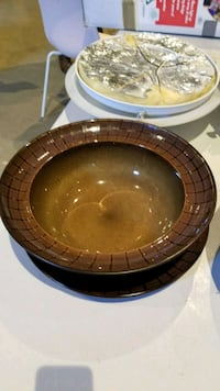 round brown and black ceramic plate