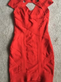 The original bandage dress color red. Fits small & small. Surrey, V3T 2R2