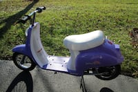 purple and white electric motor scooter 22 mi
