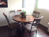 round brown wooden table with four chairs dining set San Diego, 92104