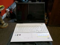 white and black laptop computer Calgary, T2G 0A3