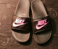 pair of gray Nike slide sandals
