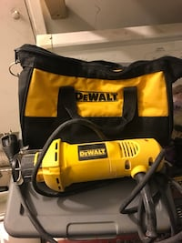 yellow and black DeWalt corded power tool