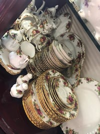 Vintage England Royal Albert Old country Roses 1962 dinner set for 8 plus ten-cup tea pot, a creamer and sugar bowl. Each place setting is included a dinner, salad, bread, cup and saucer. 43 pieces in total, excellent condition no chip or crack Hamilton, L9A 1T2