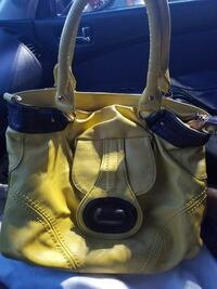 yellow and black leather tote bag
