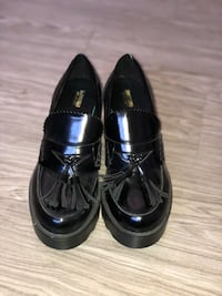 Pair of black leather tassel loafers