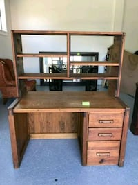 brown wooden single pedestal desk 25 km