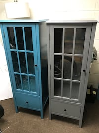 Brand new teal cabinet with glass door
