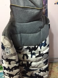 gray, white, and black camouflage bubble jacket