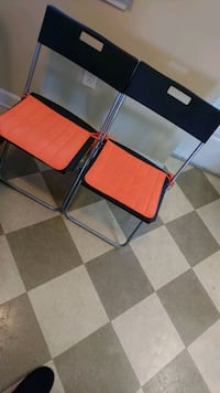 two red and white folding chairs