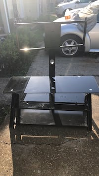 black wooden TV stand with mount 978 mi