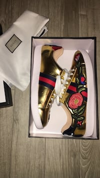 Pair of gold floral patent leather gucci low-top sneakers with box