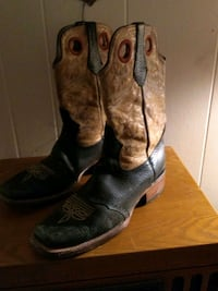 pair of brown leather cowboy boots 1133 mi