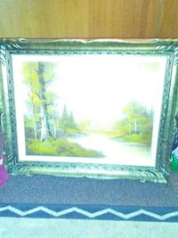 river artwork with brown wooden frame