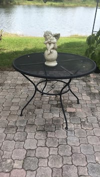 round black metal framed glass top patio table Pembroke Pines, 33029